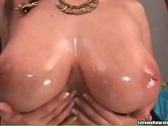 Pretty hooker Gianna Michaels likes to have her heavy boobs oiled.