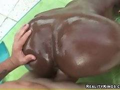 Horny dude thoroughly penetrates black chick doggy style.