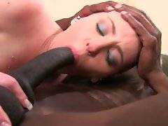 Naughty white chick gets her mouth and pussy filled with black dongs.