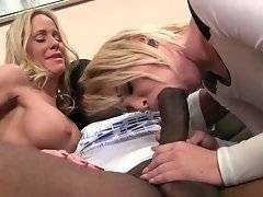Blond cutie and her hungry mommy suck one massive black cock.