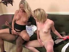 Breasted Simone Sonay is jumping on huge black cock while Miley Mae waits for her turn.