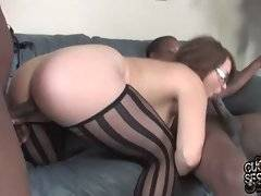 Naughty white chick in eye glasses works her mouth at two black rods.