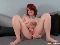 Sexy redhead Jessica Ryan is teasing tough guy by rubbing her pussy.