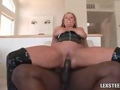 Big boobed mature slutie enjoys awesome black cock riding.