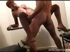 Naughty ebony chick spreads legs for horny white dude.