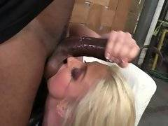 Awesome white whore is choking on huge black dong.