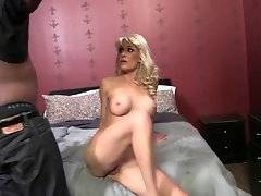Breasted blond slutie kneels down and swallows huge black dong.