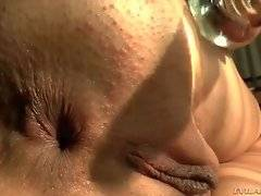 Playful Henessy demonstrates her asshole with anal plug in motion.