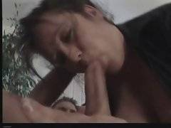 Aged brunette wraps her lips around partner`s boner.