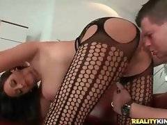 Incredibly sexy breasted brunette gets pounded doggy style.