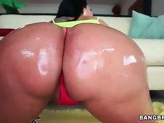 Big bottomed Kiara Mia gets her delicious ass oiled.