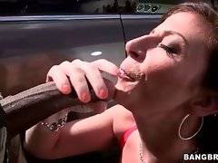Naughty curvaceous brunette hungrily swallows massive black dong.