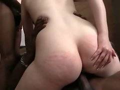 Hungry Emma Snow sucks one big black dick and rides another.
