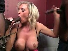 Big boobed blond hooker Allison Kilgore tastes two huge black dicks.