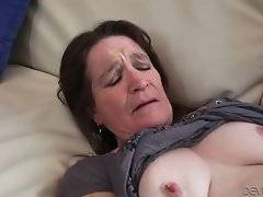 Craving brunette granny is caressing herself dreaming of good fucking.