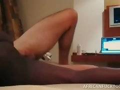 African black slutie is passionately jumping on hard white dong.