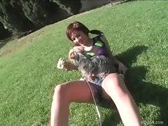 Good looking white babe plays with her doggy in park and misses her.
