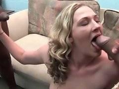 Pretty blonde works hard at two massive black boners.