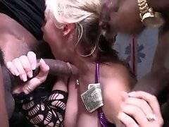 Breasted white hooker hungrily slurps massive black cocks.