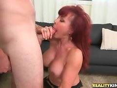 Redhead mature slutie Vanessa Bella loves to fuck with tough younger guy.