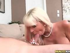 Big boobed milf Kasey Storm wraps her lips around Levi Cash`s dick.