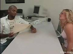 Pretty blonde is selling prescriptions to a magazines and wants this black guy to buy one.