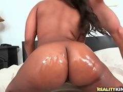 Big bottomed ebony sweetie Nina Rotti sucks and rides lover`s stiff cock.