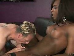 Curvaceous black she-male shoves her cock inside friend`s ass.
