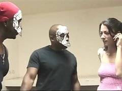 Two black dudes in dreadful masks catch white cutie in laundry.