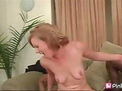 Petite white slut is jumping on one huge black cock and sucks another.