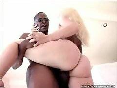 Muscled black stud and fantastic white whore are passionately fucking.