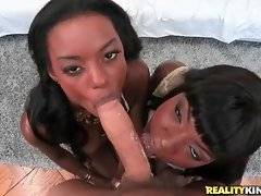 Ana Foxx and Tiffany Taylor skillfully slurp one thick white cock.