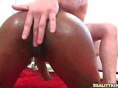 Lovely black slutie sits down on partner`s thick erect shaft.