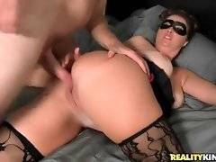 Masked mature brunette is fond of getting her pussy pounded.