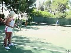 Awesome blonde and her toned friend are playing tennis.