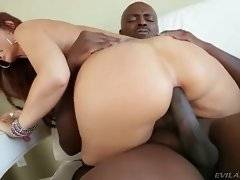 Bootylicious white lady rides big black dick with her back door.